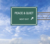 Road sign to peace and quiet — Stock Photo