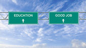 Road sign to education AND good job — Stock Photo