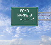 Road sign to bond market — Stock Photo