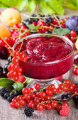 Jam with fresh berries — Stock Photo