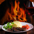 Stock Photo: Grilled meat and glass of wine