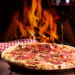 Pizza and glass of wine - Stock Photo