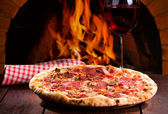 Pizza and glass of wine — Stock Photo