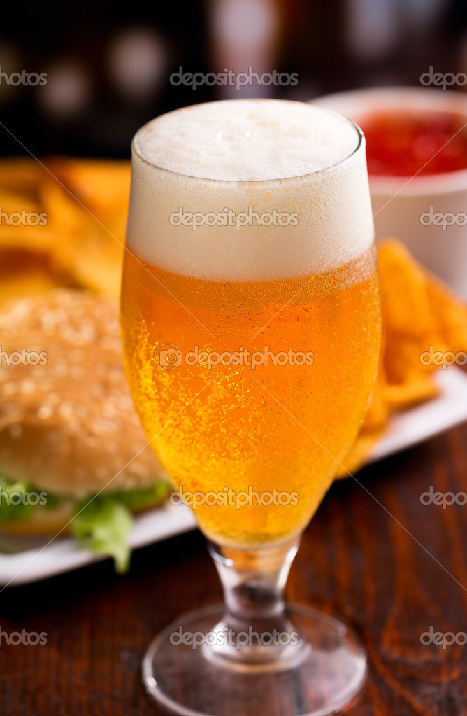 Glass of beer and different snack — Stock Photo #13517451