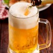 Beer pouring — Stock Photo #13684544