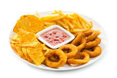 Onion rings, fries and nachos — Stock Photo