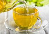 Pouring tea — Stock Photo