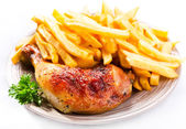 Roasted chicken leg with fries potato — Stock Photo