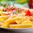 Plate of penne pasta — Stock Photo #24528227
