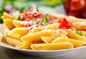 Plate of penne pasta — Stock Photo