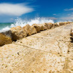 Wave splash against breakwater — Stock Photo #25934425