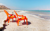 Chairs on beach of dead sea — Stock Photo