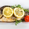 Grilled fish with lemon — Stock Photo #26931893