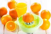Orange squeezer with fresh fruits — Stock Photo