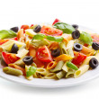 Plate of colorful pasta with vegetables — Stock Photo