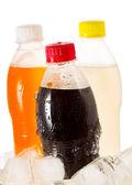 Cold bottles of soda in ice — Stock Photo