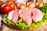Raw chicken breast with vegetables — Stock Photo