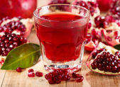 Glass of pomegranate juice with fresh fruits — Stock Photo