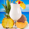 Cocktail pina colada with fresh fruits — Stock Photo