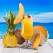 Tropical cocktail with fresh fruits — Stock Photo