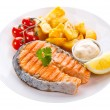 Plate of grilled salmon steak with vegetables — Stock Photo #45935903