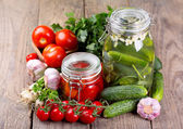 Canned tomatoes and cucumbers — Stock Photo
