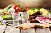 Glasses of vodka with traditional  snack — Stockfoto