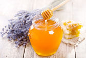 Jar of honey with honeycomb and lavander flowers — Stock Photo