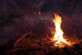 Night sky and camp fire — Stock Photo