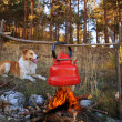 Dog and campfire — Stock Photo