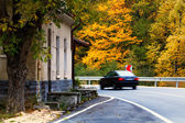 Autumn road and car — Stock Photo