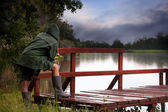 Fisherman in stormy lake  — Stock Photo
