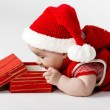 Cute christmas baby with gift — Stock Photo