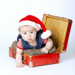 Cute baby with santa hat and suitcase — Stock Photo #14964233