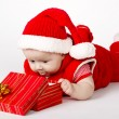 Cute cristmas baby with gift - Stock Photo