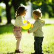 Boy and girl playing with ball — Stock Photo