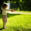 Stock Photo: Little beautiful girl in park