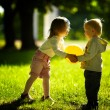 Boy and girl playing with ball — Stockfoto