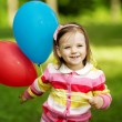 Little girl plays with balloons — Stock Photo #17214695