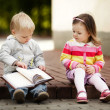 Stock Photo: Boy and girl reading book