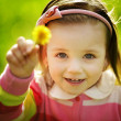 Little funny girl with dandelion — Stock Photo