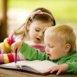 Foto Stock: Boy and girl learning