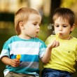 Little boys playing with bubbles — Stock Photo