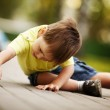 Little boy plays with toy car — Stock Photo #17455345