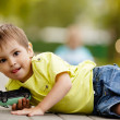 Stock Photo: Little boy plays with toy car