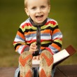 Little funny boy writes with pen — Stockfoto