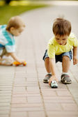 Little boy plays with toy car — Stock Photo