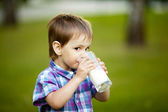 Little boy with glass of milk — Stock Photo