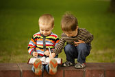 Two boys learn to write and read — Stock Photo