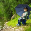 Little boy with umbrella — Stock Photo